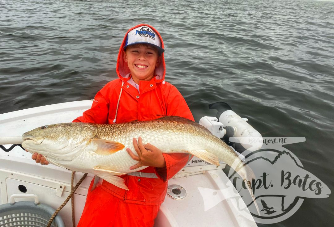 Had Buddy out catching trophy redfish on a stormy evening!