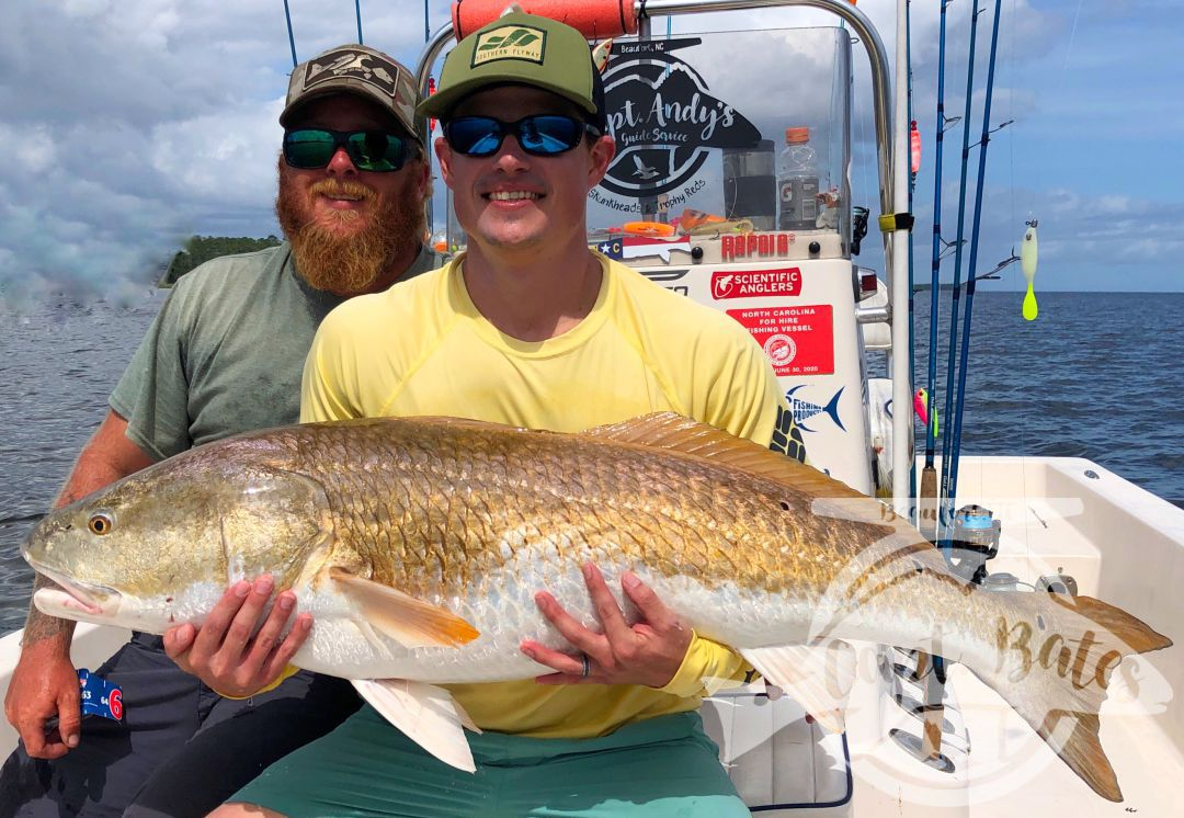 """Nathan with a stud 50"""" male red drum! So dude lands his first ever citation trophy drum, and then a few minutes later crushes his new personal best, with one of the largest males I have ever put in the boat! These guys stuck it out with with me today, high winds and post cold front conditions early, after lunch everything laid out and conditions came together for an epic bite!"""