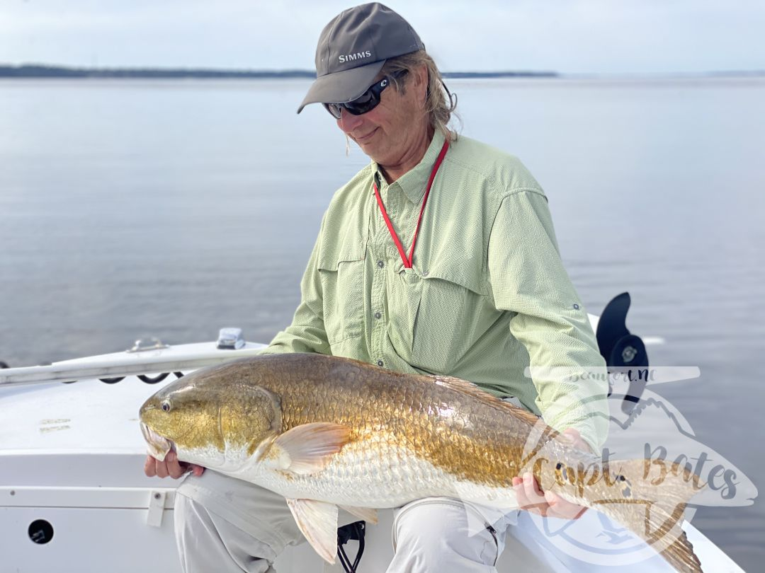 Mr Jim admiring the first of many trophy redfish he caught in two days fishing with me.