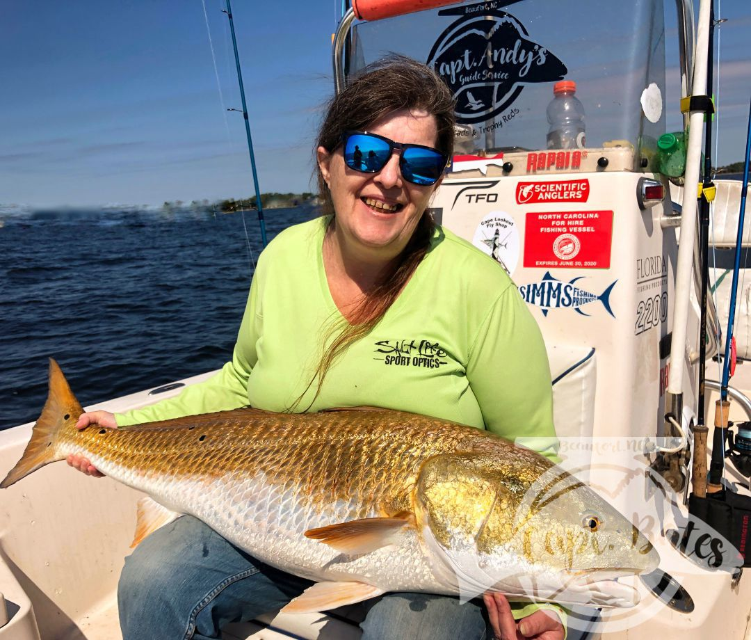 """Had a great day with a long time friend and his wife, he's no stranger to redfish or trophy drum, all he wanted was his wife to get her first citation North Carolina red drum. And she did! She did a great job battling these neuse river buffalos and her biggest of the day was 45""""!   Tim has been a great friend over the years and would do anything for anyone, so I was super stoked he got him one as well!   Had a couple break off around the motors, and a miss or two, but hell, a you can make a lot of money in the majors batting .500!   Really pretty conditions early, then wind picked up a little bit was still comfortable fishing.  Time got his first trophy red fish on the popping corks and Mrs Ruthie got her biggest ever! What an awesome day!"""