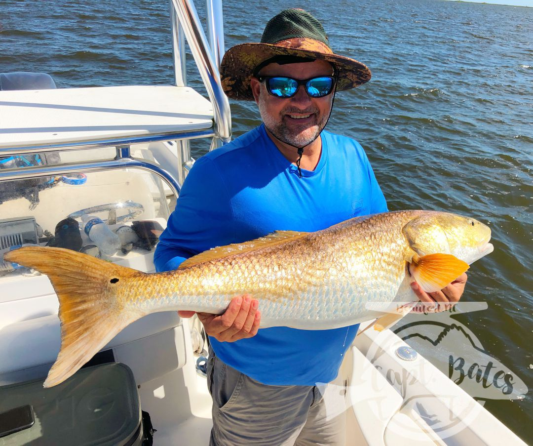 "What an awesome couple I had the pleasure of having on the boat today! Mr Harvey has been fishing all over the country, and has been wanting a citation red drum for a long time. He also really wanted to hit that 50"" mark, well he did both today! Him and Mrs. Tina are trying to spend more time together, and experience different things. Well, they got to experience about the best of what the Neuse River has to offer! Mrs. Tina went from admitting she didn't have much experience fishing, to casting and hooking trophy fish like a pro, she ended up landing several all on her own. Seeing them learn what we're looking for and how to properly work the artificial bait on the TFO Rods was great, congrats guys! Look forward to sharing the boat with y'all again."
