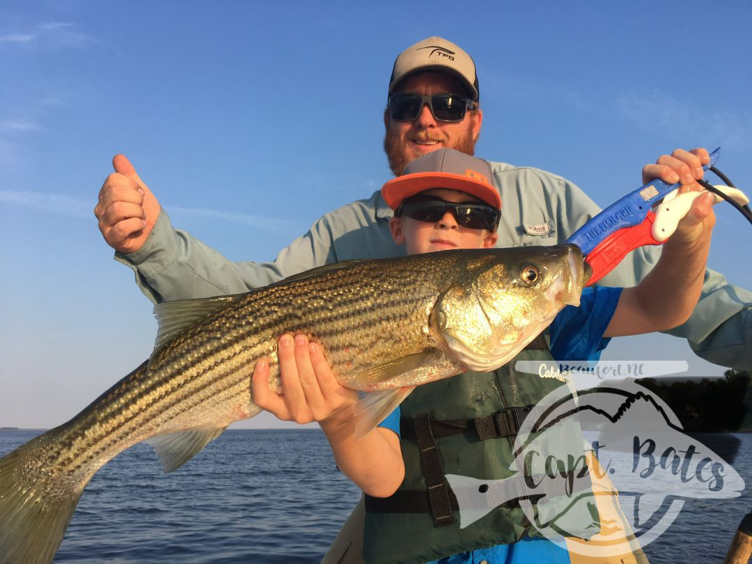 Troy Troy with a hawg of a rockfish! Topwater on the Neuse River in North Carolina can be incredible!
