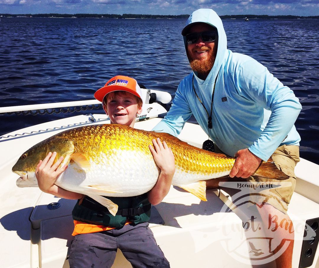 "Troys biggest redfish ever! Did it all by himself! other then having to hold his lifejacket, Monster 48"" fish!"